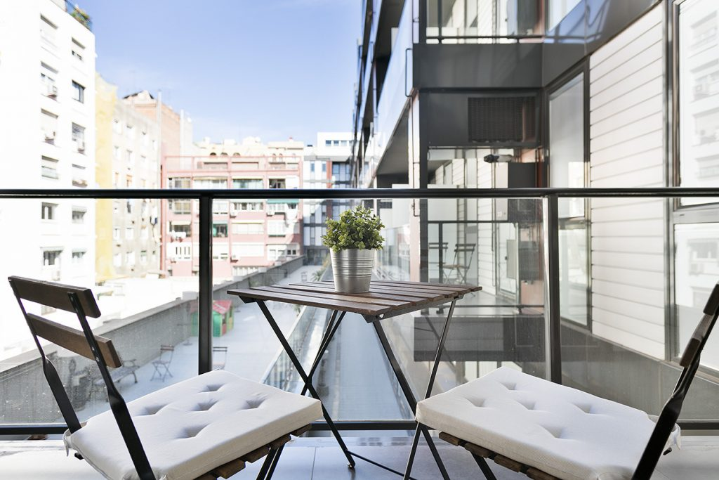 Balcony with two chairs and table overlooking Barcelona