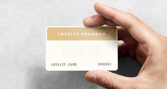 Man holding Guest Loyalty card